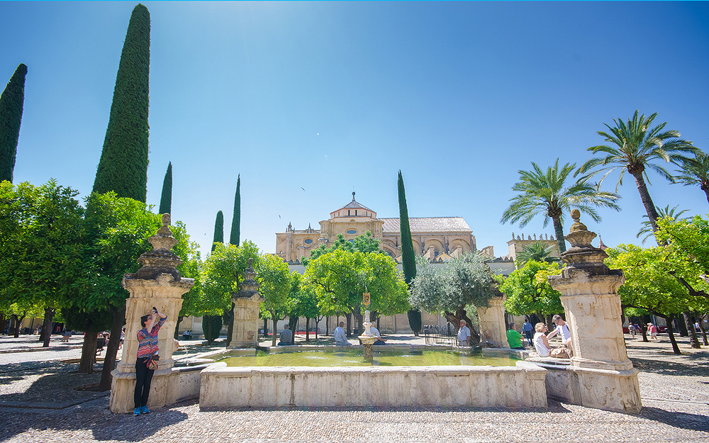 The vast entrance of Mezquita with the famous fountain - Córdoba, Spain.