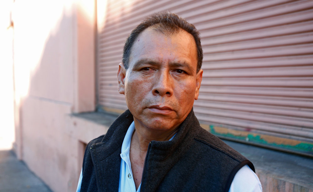 Javier Garcia Martinez has been working in downtown Los Angeles garment factories since 1979. He earns about $9 an hour ironing clothes at a sewing contractor that produces clothes for TJMaxx. (Claire Hannah Collins / Los Angeles Times)