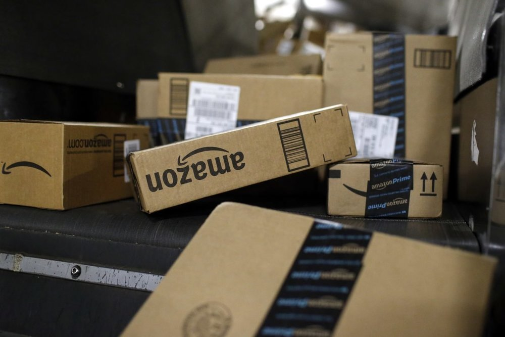 Amazon boxes ride a conveyor belt at the UPS Worldport hub in Louisville, Ky