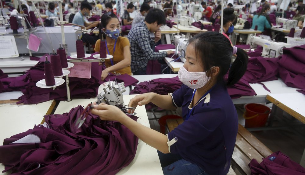 Crystal Group is investing in more workers like these in Vietnam, not robots. (Reuters/Kham)