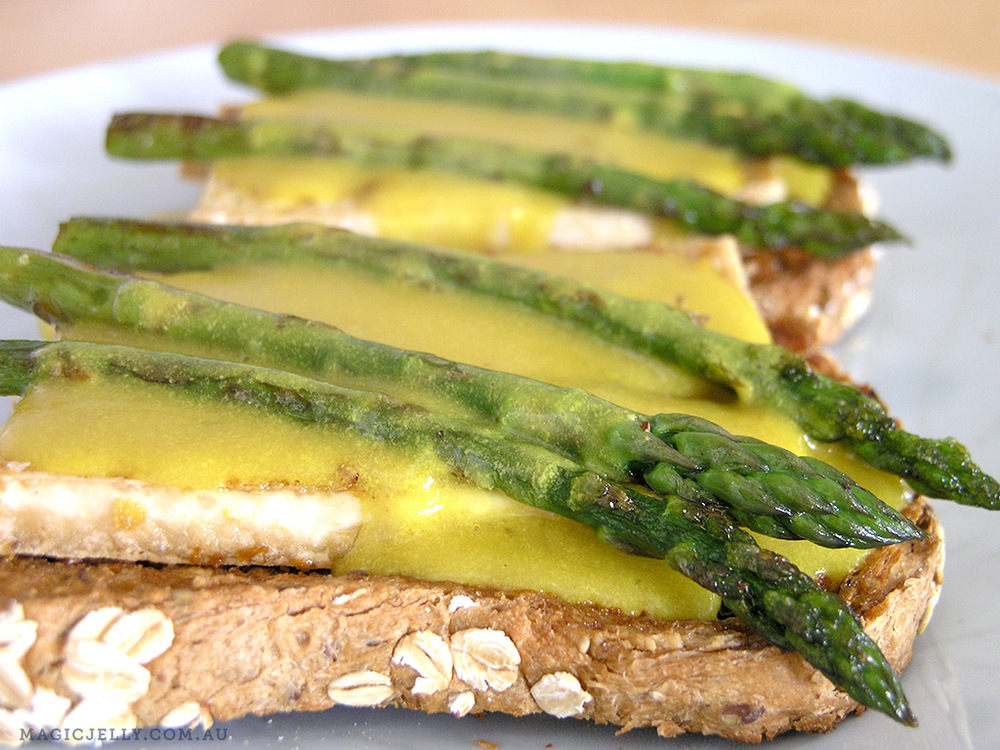 Tofu Sunny Side Up, with sauteed asparagus, on grainy toast.