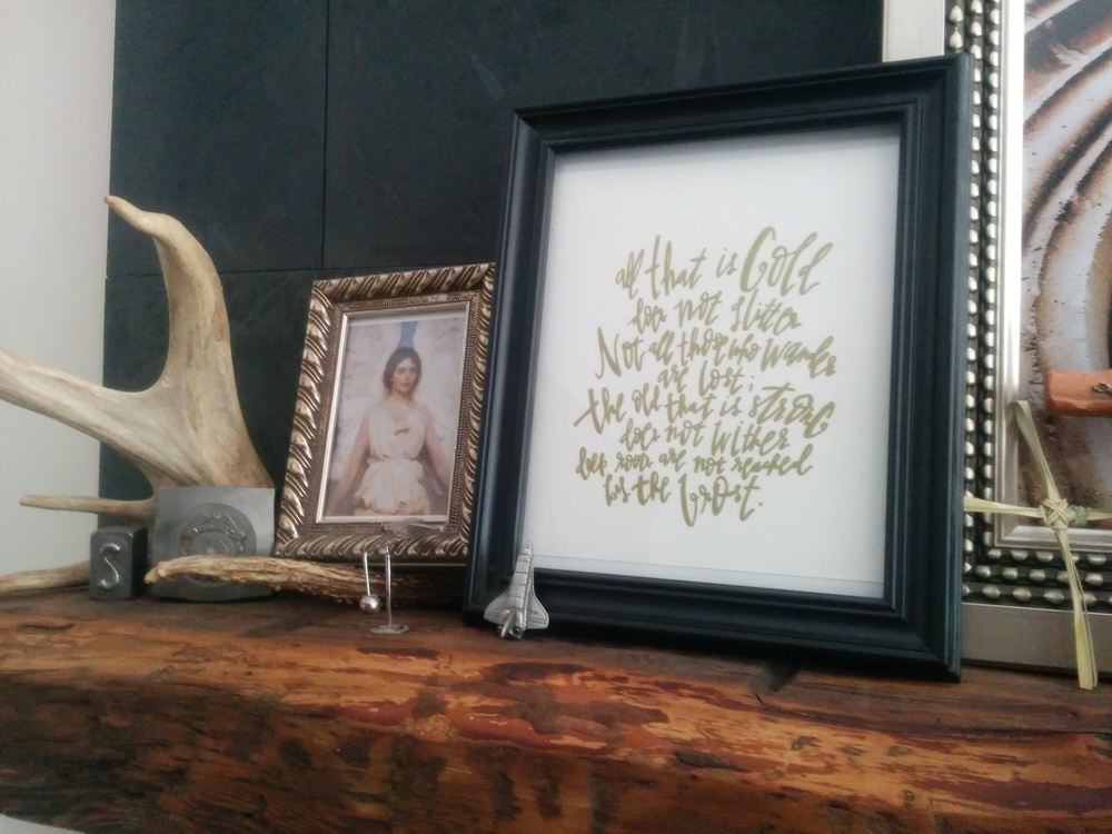 My own mantle, with a favourite Tolkein quote: hand-written by the talented Eva Zellmer of Gritshop on Etsy