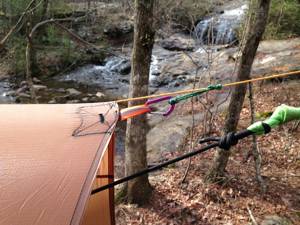 Tarp attachment to ridge line with Prusik knot and carabiner.