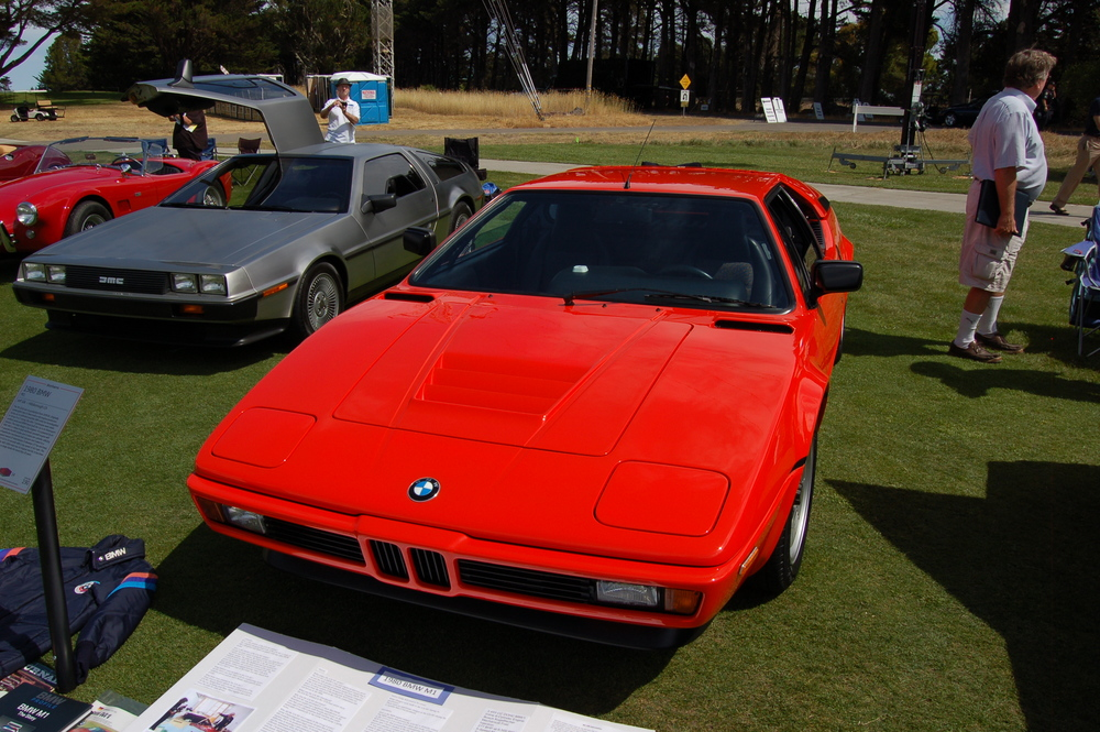 1980 BMW M1. Note all the accessories, documents, and some of the toolkit in front of the car.