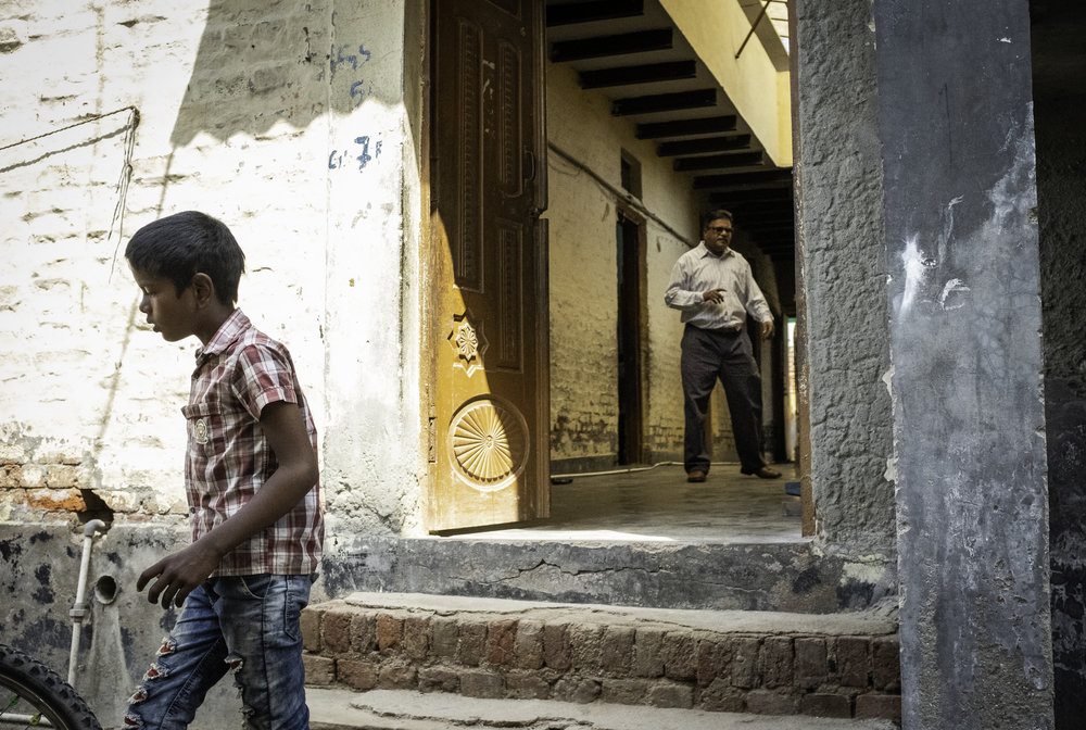 A child exits a former Compassion International school site in New Delhi, India. In 2017, Indian Prime Minister Narendra Modi's Bharatiya Janata Party declared that Christian Non-Governmental Organizations operating within India could no longer receive funding outside the country. Compassion International, a major provider in education and orphan care, was forced to cease its operations, leaving thousands of children without the provisions they needed to survive. Non-Profit organization Genesis of Hope has managed to maintain several former C.I. school sites, but must fight constant heavy financial challenges to move forward for the children.       New Delhi, India. 2018