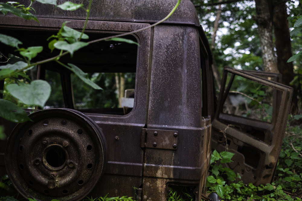 A destroyed jeep still sits where it was last parked in the courtyard of a Catholic compound in Kandhamal, India. During the Summer of 2008, and violent mob of Hindu nationalists forcibly entered the property where they proceeded to rape the nuns and destroy the building, and set fire to the jeep. The compound has since been rebuilt, and remains active in ministry.       Kandhamal, India. 2018