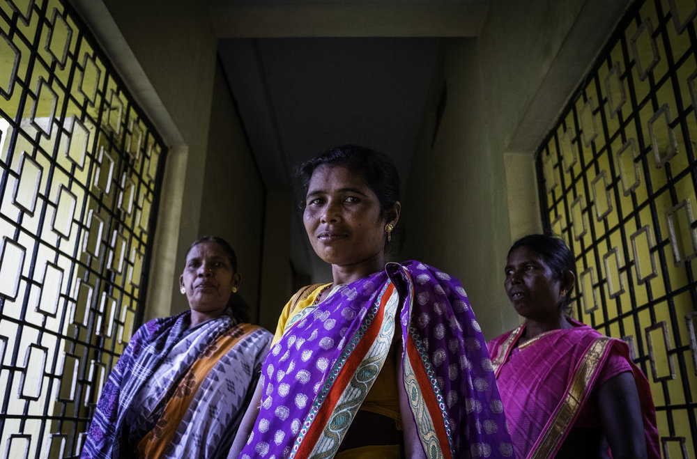 A group of Christian widows whose husbands were murdered for their faith during the Summer of 2008, meet together often in Kandhamal, India. Together they mourn, pray, and encourage each other to move forward in their relationships with Jesus Christ.       Kandhamal, India. 2018