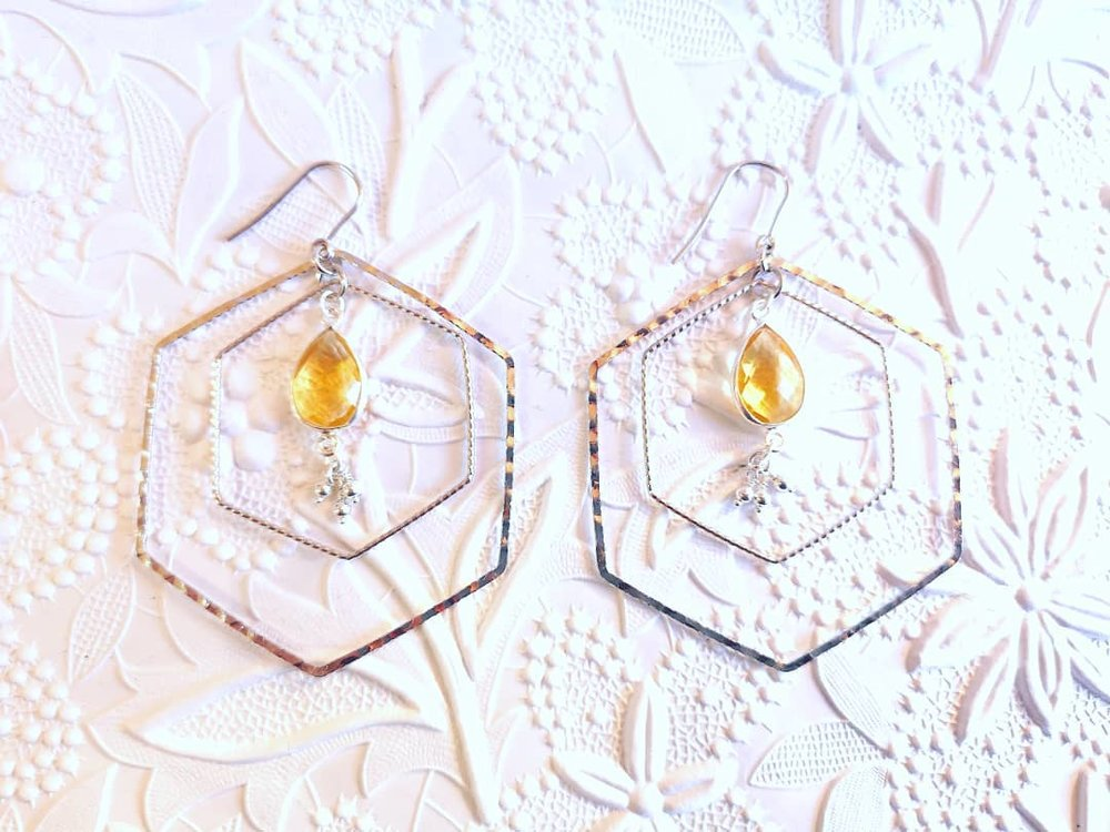 Did you know all our jewellery with a bee themed motif goes directly into the proceeds of keeping our bees healthy and happy? Sterling silver and citrine drop hexagon earrings.