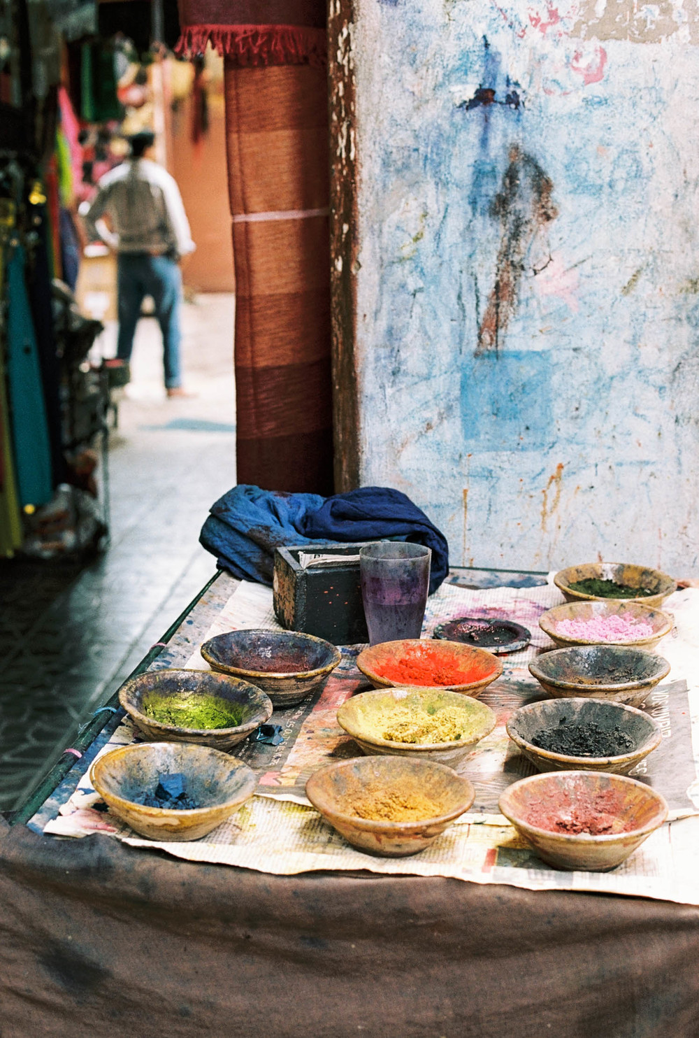 Natural dyes made from local materials are used to dye fabrics.
