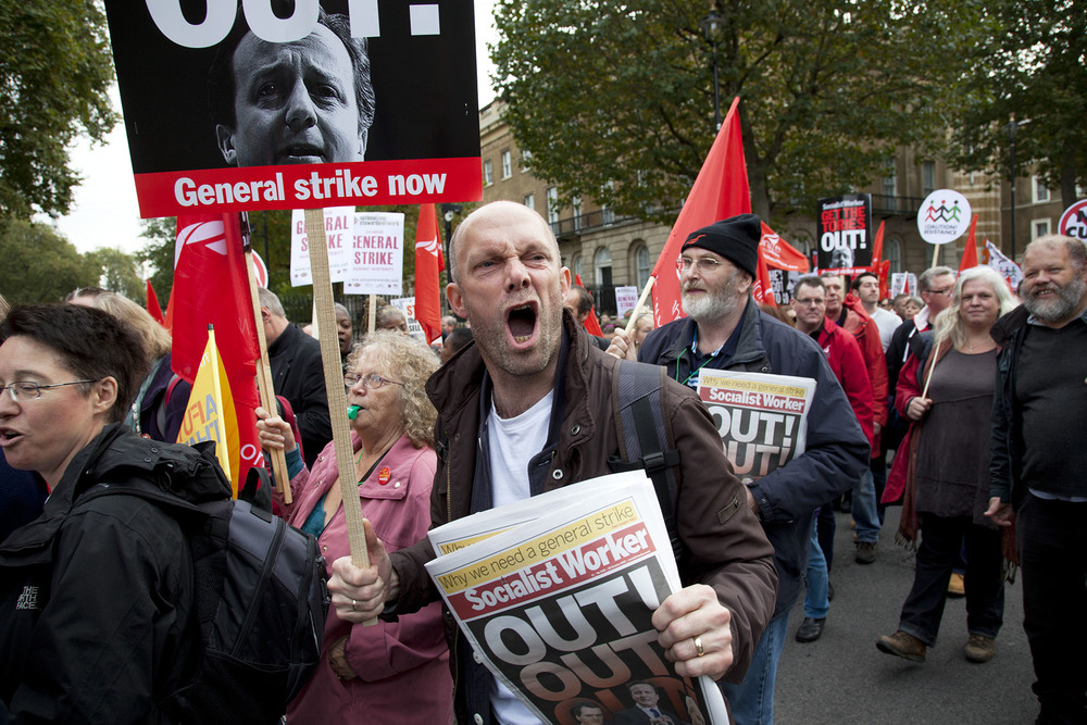 Protester shouts towards Downing Street during the TUC march 'A Future That Works' demonstration against austerity cuts.