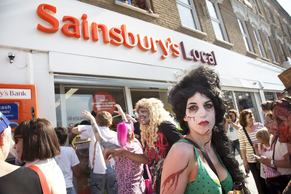 An undead Amy Winehouse at the Stoke Newington Zombie-a-thon protests against Sainsbury's supermarket in the area.