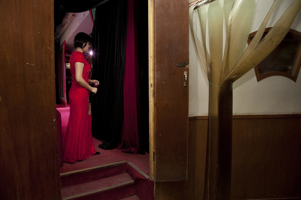 Female compare in her red dress at Laoshe teahouse.