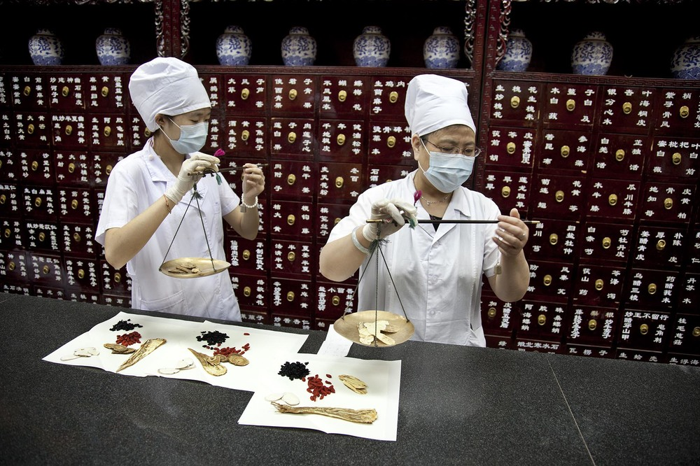 Preparation of traditional Chinese medicine at the Beijing Tongrentang drug store.