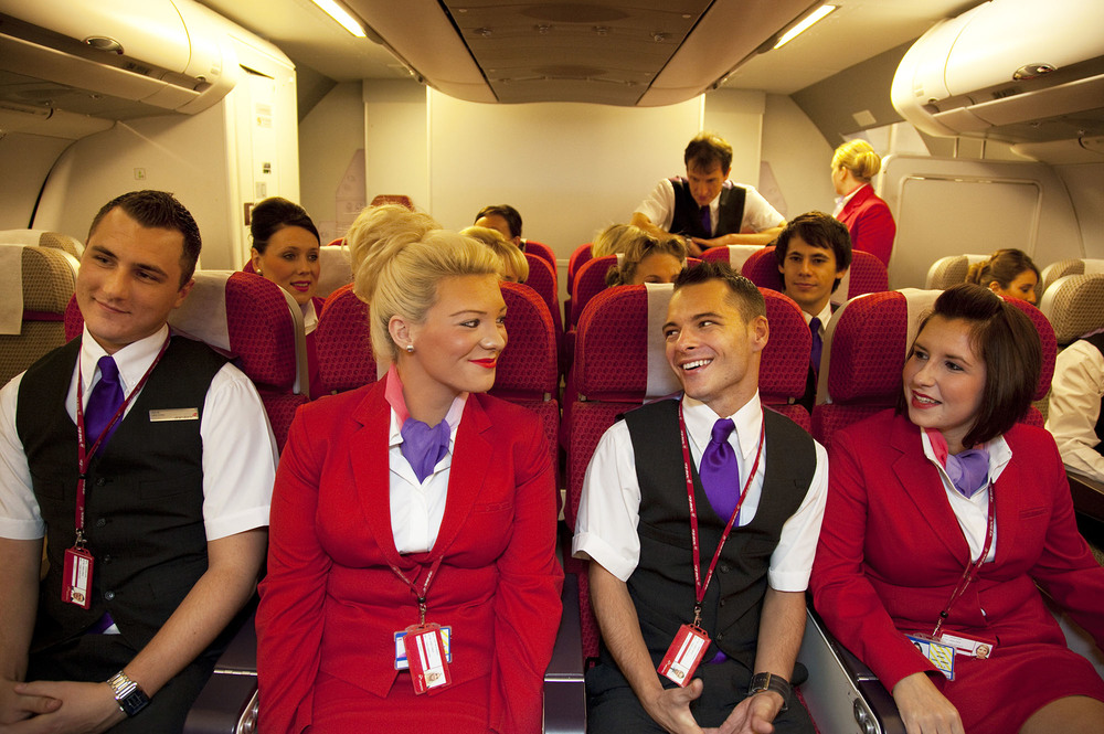 Virgin Atlantic air stewardess and steward training aboard a simulated cabin at The Base training facility, UK.  For The Washington Post.