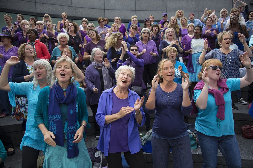 Thames Festival 2014. Adults choir sing at The Scoop.  For Totally Thames.