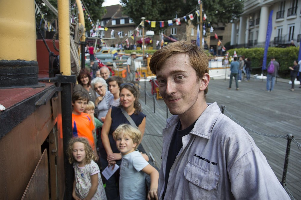 Thames Festival 2014. Volunteer gives a guided tour aboard a steam boat.  For Totally Thames.