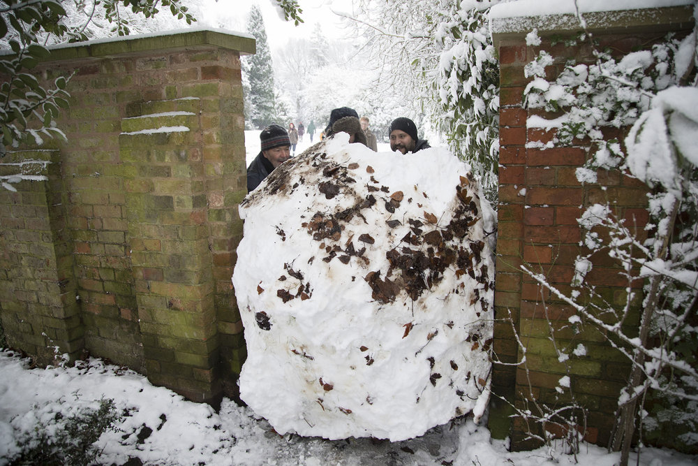 People of Birmingham out playing after heavy snowfall.