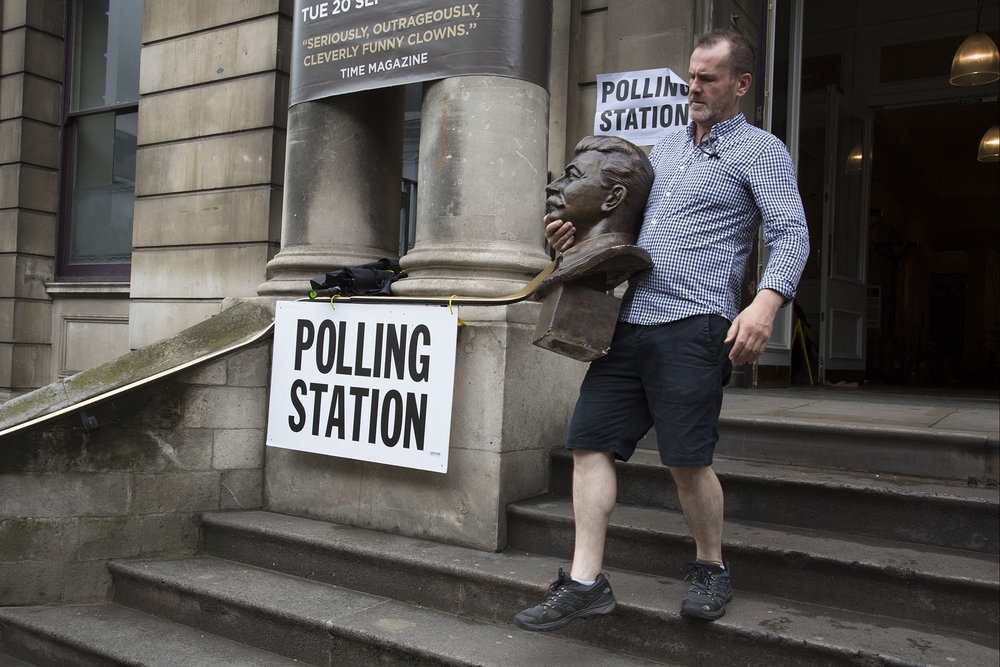 Workman removes the head of Joseph Stalin at Shoreditch Town Hall during the EU Referendum polling day on June 23rd 2016.
