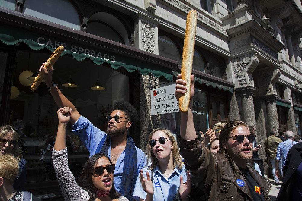 Protesters waving baguettes singing 'baguettes not regrets!' as tens of thousands of people protest in the March for Europe against Brexit demonstration.