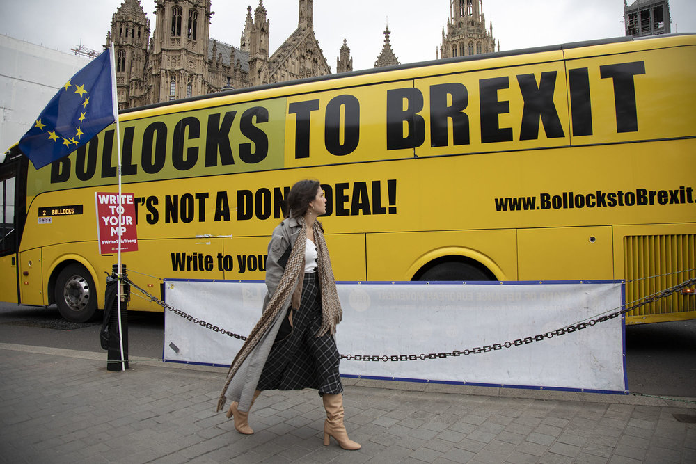 Anti Brexit bus with the slogan Bollocks to Brexit on the day of the first 'meaningful vote' when MPs will back or reject the Prime Minister's Brexit Withdrawal Agreement on 15th January 2019.