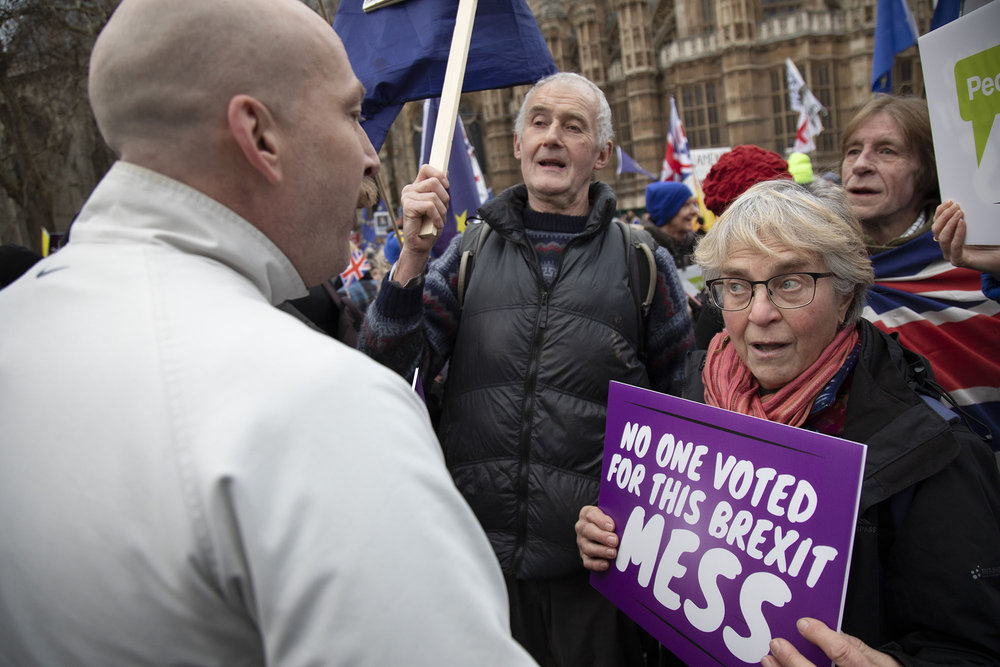 Anti Brexit demonstrator debates with a Leave supporter on the day MPs vote on EU withdrawal deal amendments on 29th January 2019.