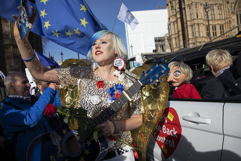 Anti Brexit demonstrator dressed as an angel at the protest opposite Parliament as MPs debate and vote on amendments to the withdrawal agreement plans on 14th February 2019.