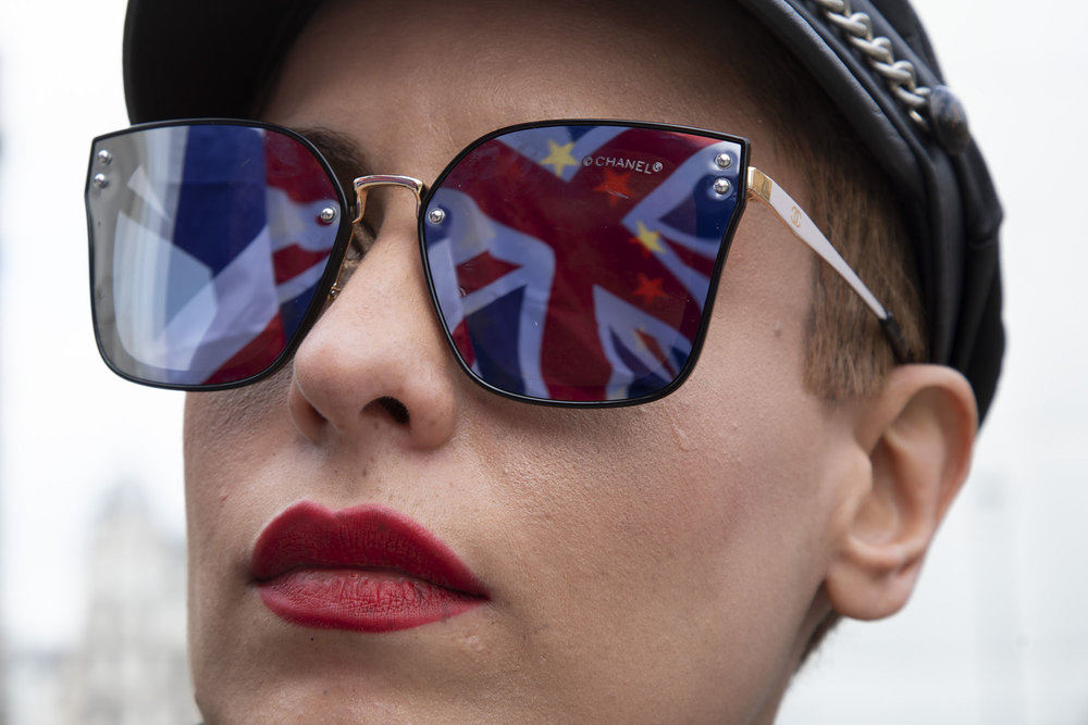Union flag combined with the European flag reflection in Westminster on 26th March 2019 as the date of the UK leaving the European Union is extended.