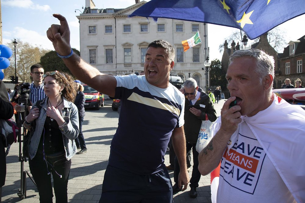 Pro Brexit protester shouts for Steve Bray, the anti Brexit protester to show his identification saying he is 'a fake', as the Prime Minister arrives in Brussels to request an extension to Article 50 on 10th April 2019.