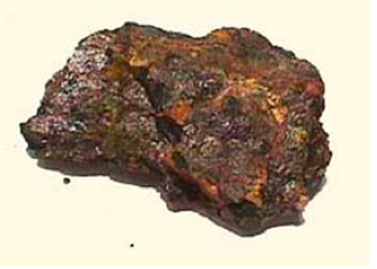 A lump of pitchblende. Marie found this mineral was far more radioactive than could be accounted for by the amount of uranium it contained.