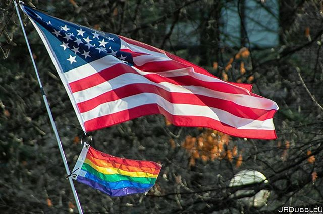 Along with the symbolism (credit for that given to the flag flier) this is one of my favorite photographs. Every time I look at it I get shivers. I've shared it before but for #pridemonth I'll share it again. . . . . #unityindiversity #pride #canon_photos #starsandstripes #rainbowflag