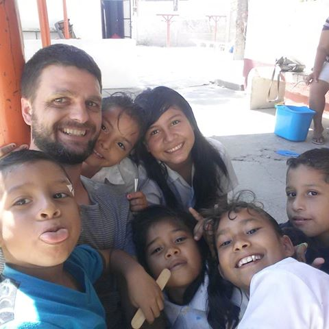 Matt Metzger with some of the children from an orphanage in Mazatlan, Mexico.