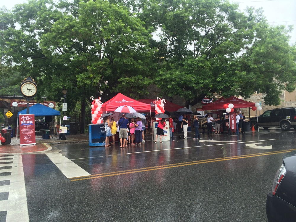 The crowd (and DJ) huddled under the tents and umbrellas. Several of the Main Street business owners and patrons of the Historic district came to celebrate despite the rain showers.