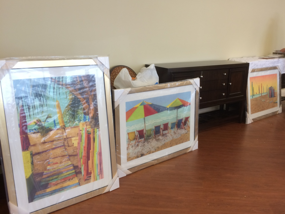 The artwork about to be mounted to the walls by Kevin Barry Associates.