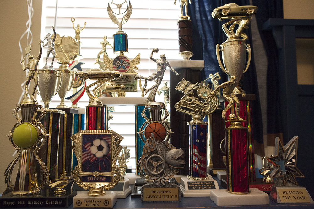 In Branden's room he has a large collection of trophies. Before life had changed at the age of eight, Branden played soccer. During the years family and friends continue to gift Branden with a trophies to remind him how special he is., Tampa, FL.