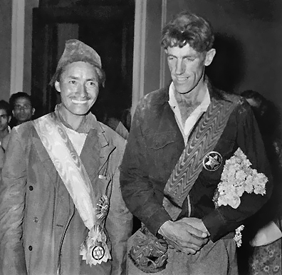 Tenzing Norgay and Edmund Hillary wear decorations given them by the Kingdom of Nepal after their historic ascent of Mt. Everest.