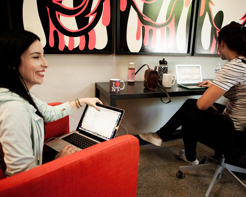 Kelsey Ruiz and Madison Andermahr, Angel Hack marketing team members, discuss strategy and their next hackathon coding event.