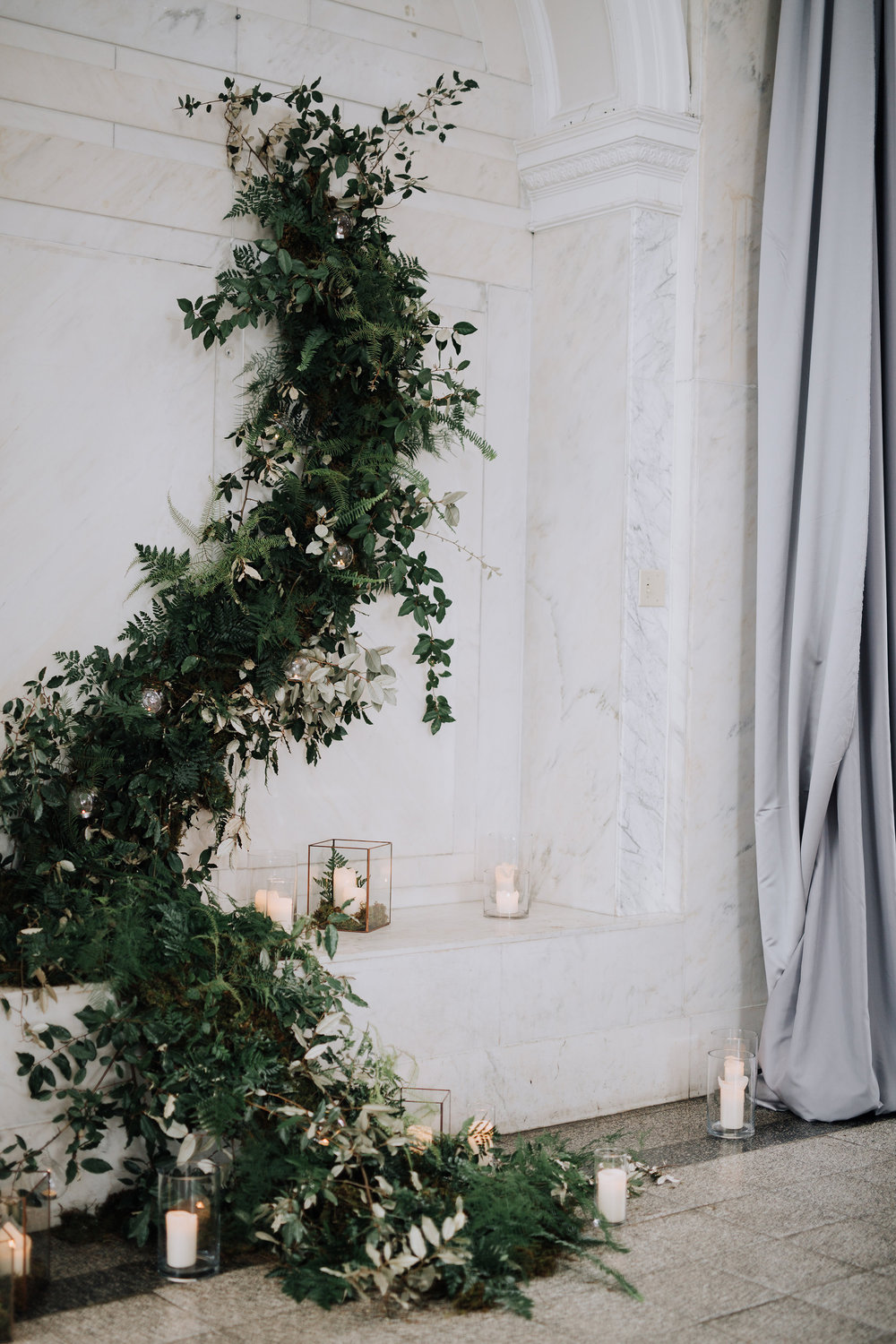 This was in 2016 at the Old Decatur Courthouse. The client wanted to bring the outdoors in so we decided to create a climbing greenery wall for their ceremony backdrop. We actually placed a 12 foot ladder inside of this alcove. Don't you worry about the mechanics behind all of it, I can promise you though it wasn't going anywhere. Image by Twin Hearts Photography.