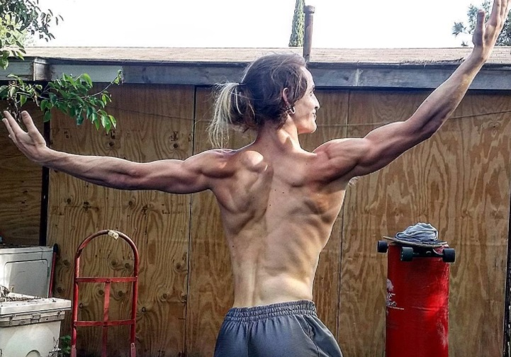 Joel Matlock stretches in his backyard after training.