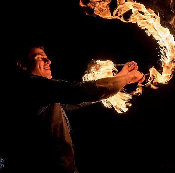 Marcos Rangel spins fire poi.