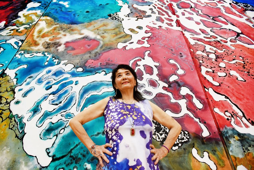 Marlene Tseng Yu on her 80th Birthday in front of her artwork, 80 times her size