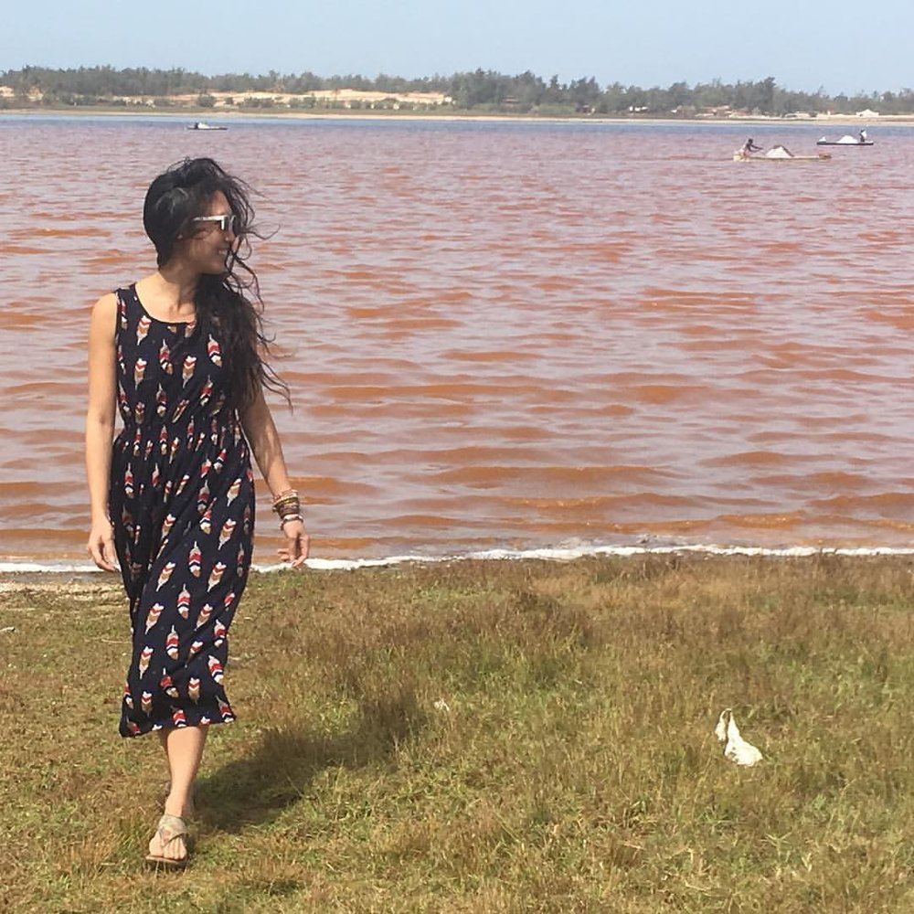 Wow. It really is pink! Behind me, men hand-harvest salt in wooden dug out boats called pirogues.