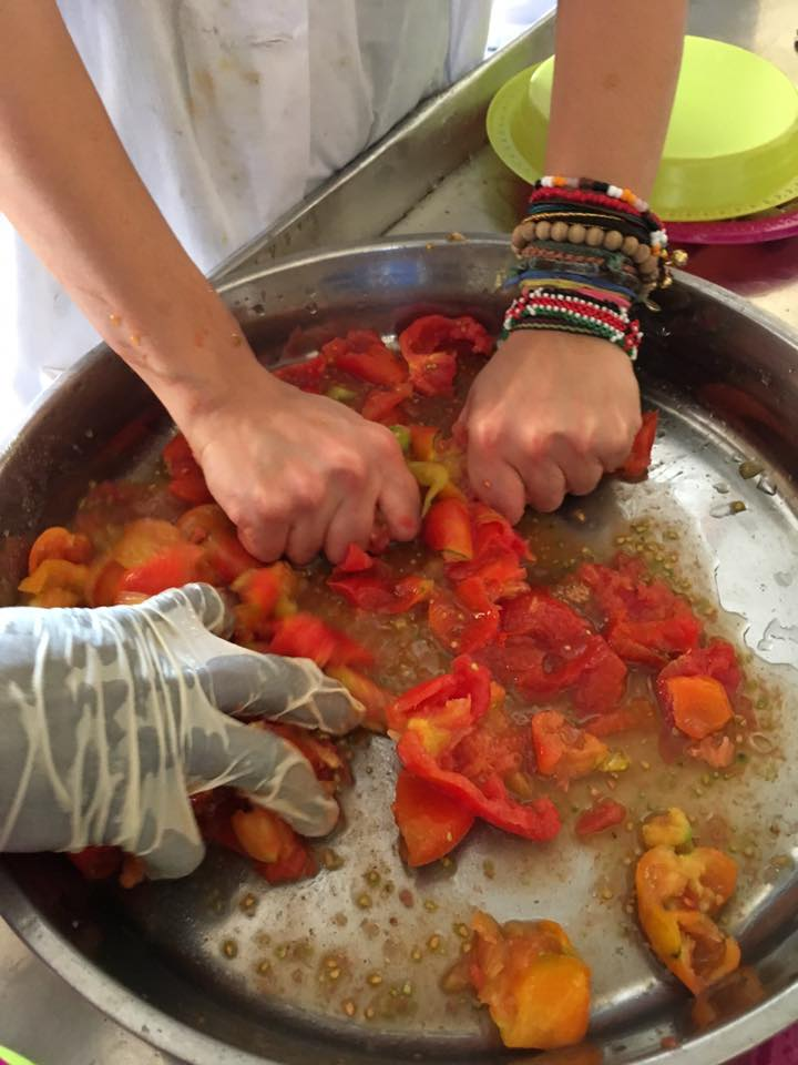 Hand-processing tomatoes... I did wash my hands by the way!