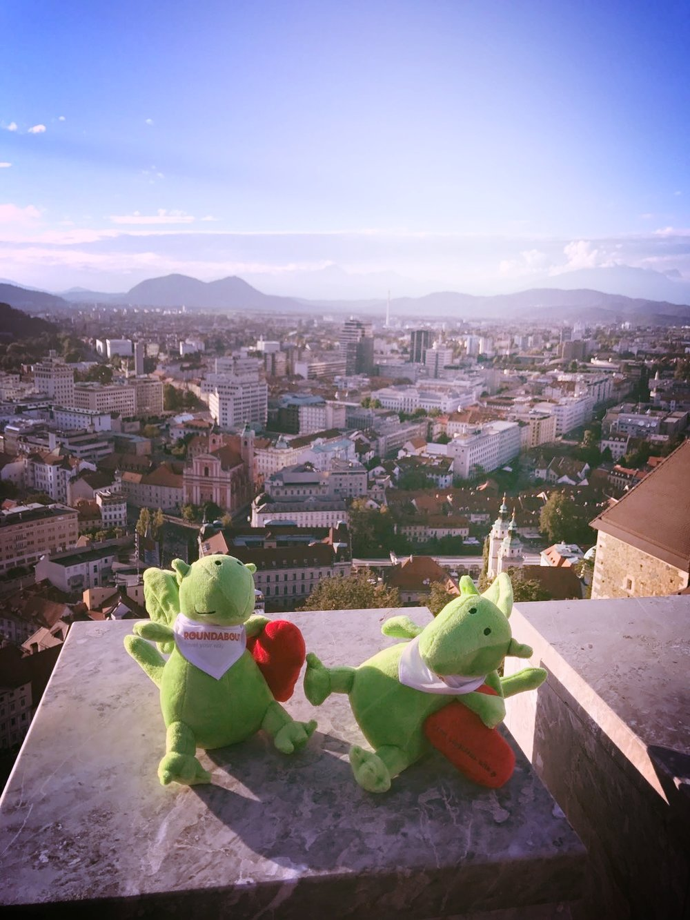Hanging at Ljubljana Castle - a hilltop historical and art museum that offers summer outdoor screenings of the latest films - with our new friends, Roundabout Travel's cute mascots, Roundy the Dragon.