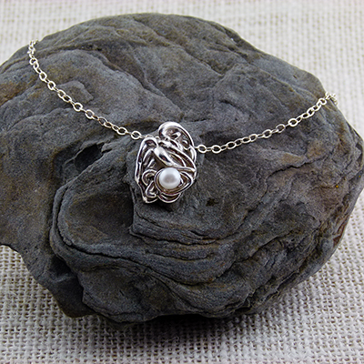 "Hot wax drizzled in water cast pendant with fresh water pearl, 18"" sterling silver chain - $95."