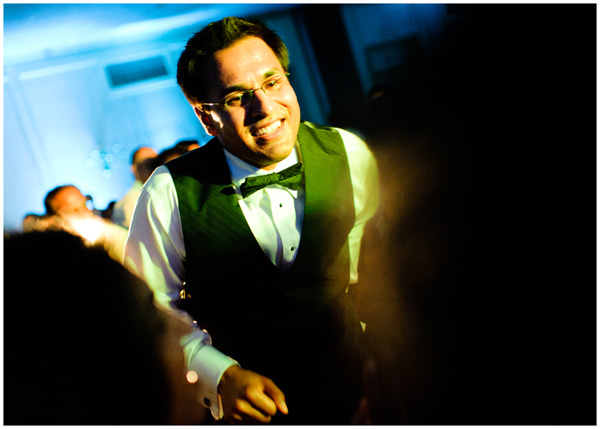 groom dancing in reception