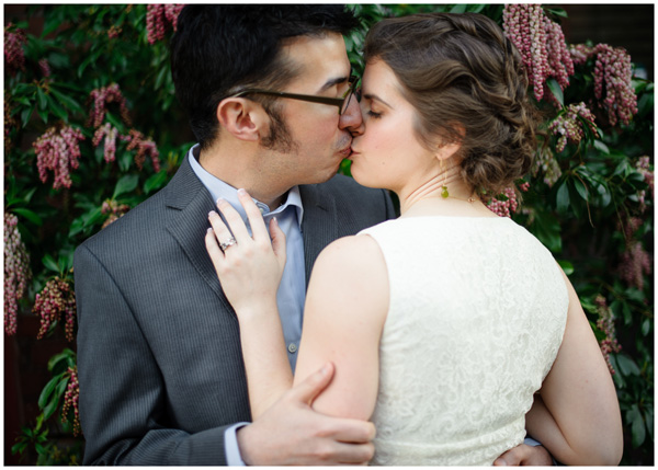 oregon bride groom portrait kiss flowers