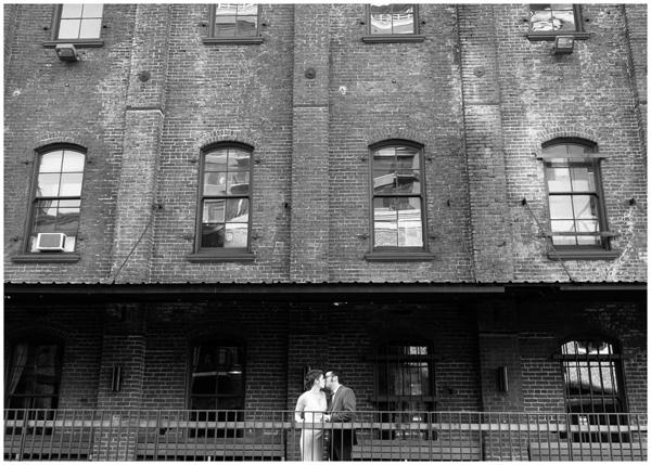 black white portland kiss brick building wedding