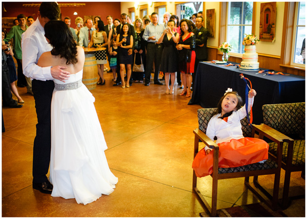 flower girl playing during first dance
