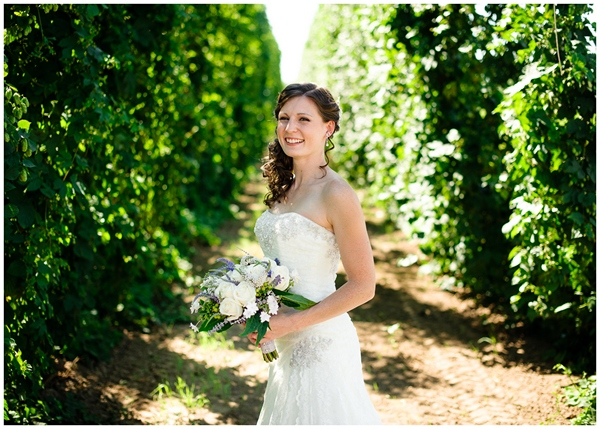bride laughing in hopyard