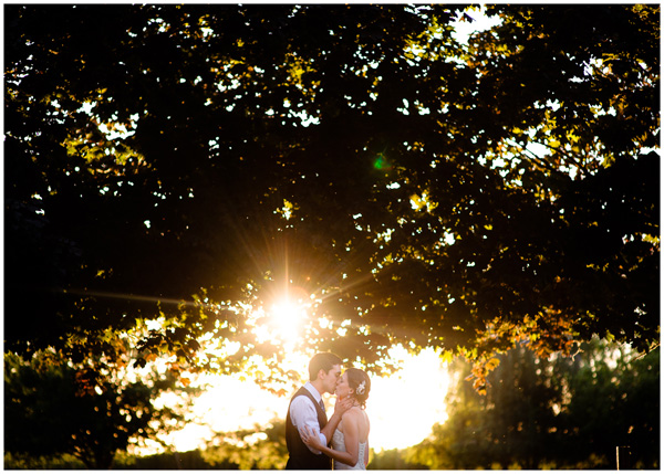 gorgeous sunset last kiss at rogue wedding